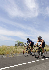 US_Navy_091006-N-0555B-471_t._Cmdr._Don_Cross_left_and_Cmdr._David_Haas_train_on_the_Kuakini_Highway_for_the_2009_Ford_Ironman_World_Championship