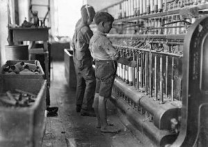 10-25-15-Child laborer in a spool mill