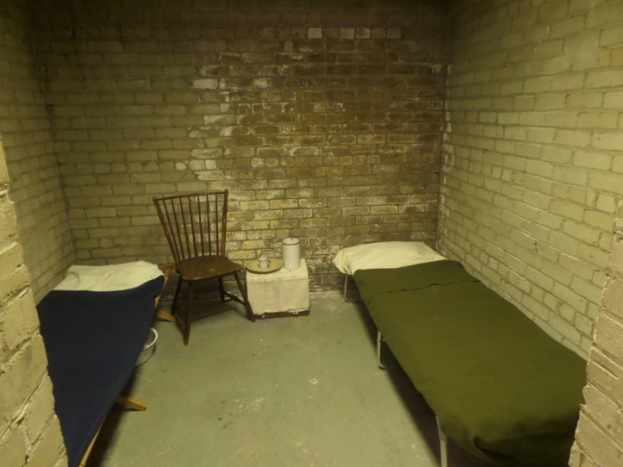 Doing Time: Above, Troy Township's original jail cell, dressed to look similar to how it may have in the early days.