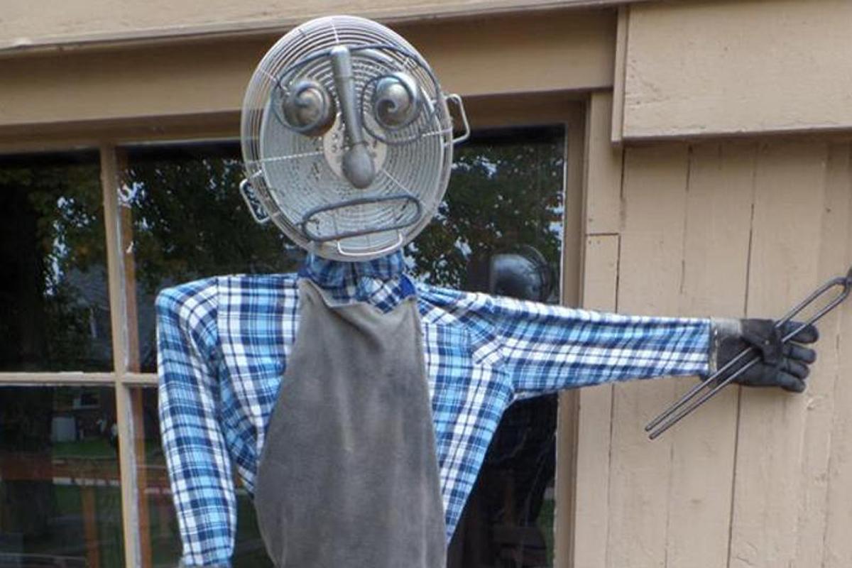 Blacksmith scarecrow hard at work