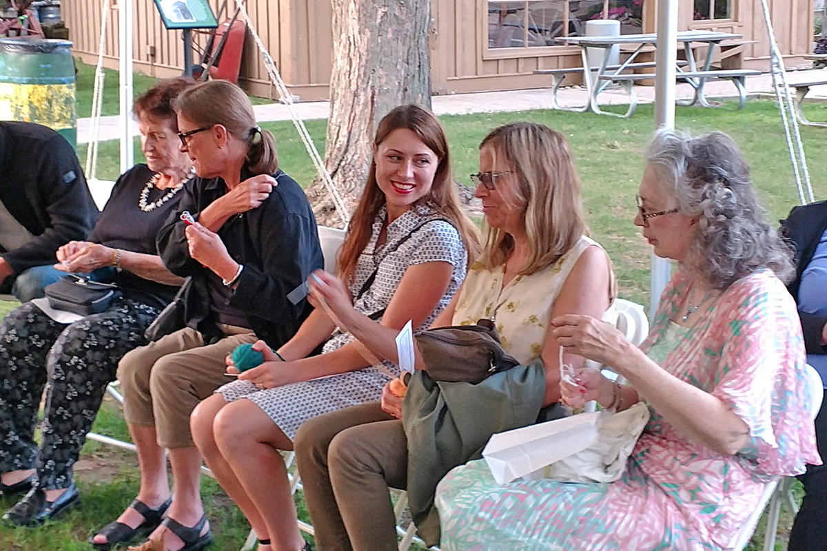 Threads Play with the audience seated in the Village Green tent.