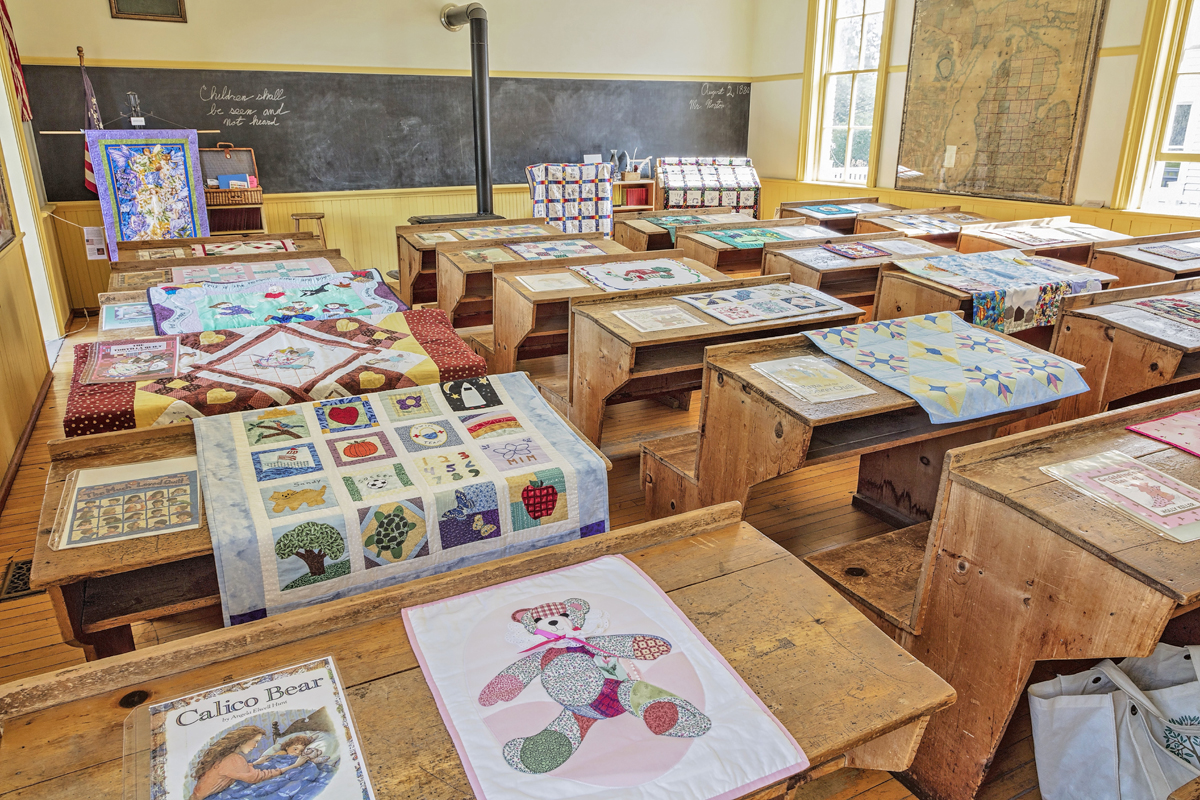 Threads Story Quilts shown in the Poppleton School.