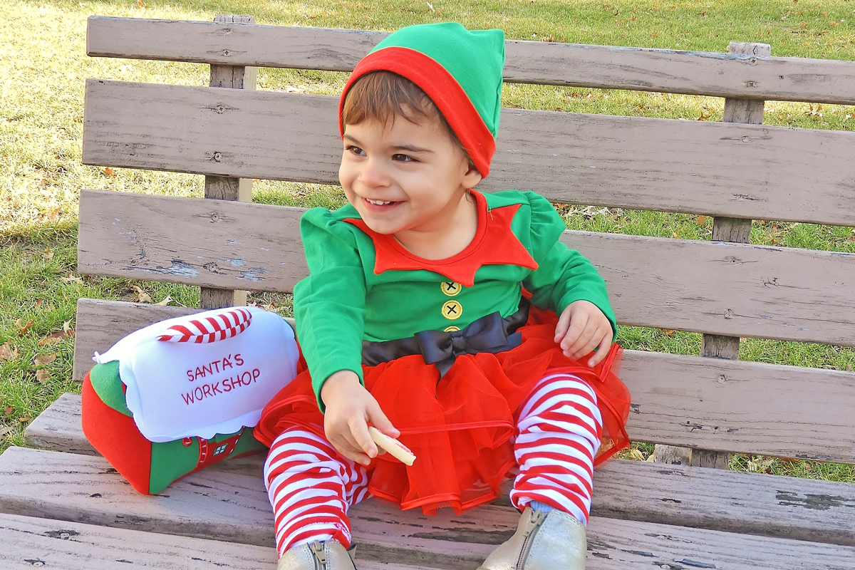 A happy little Elf in the Village Green