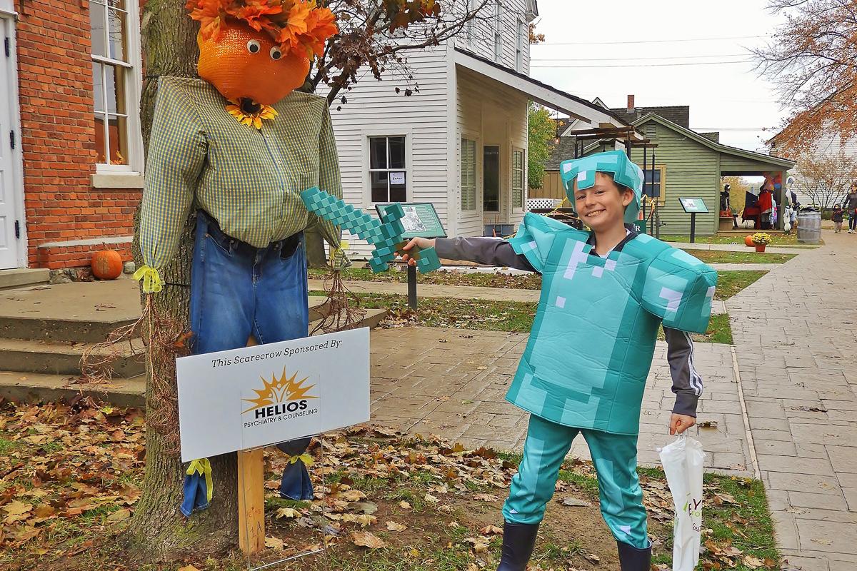 Halloween scarecrow versus trick-or-treater