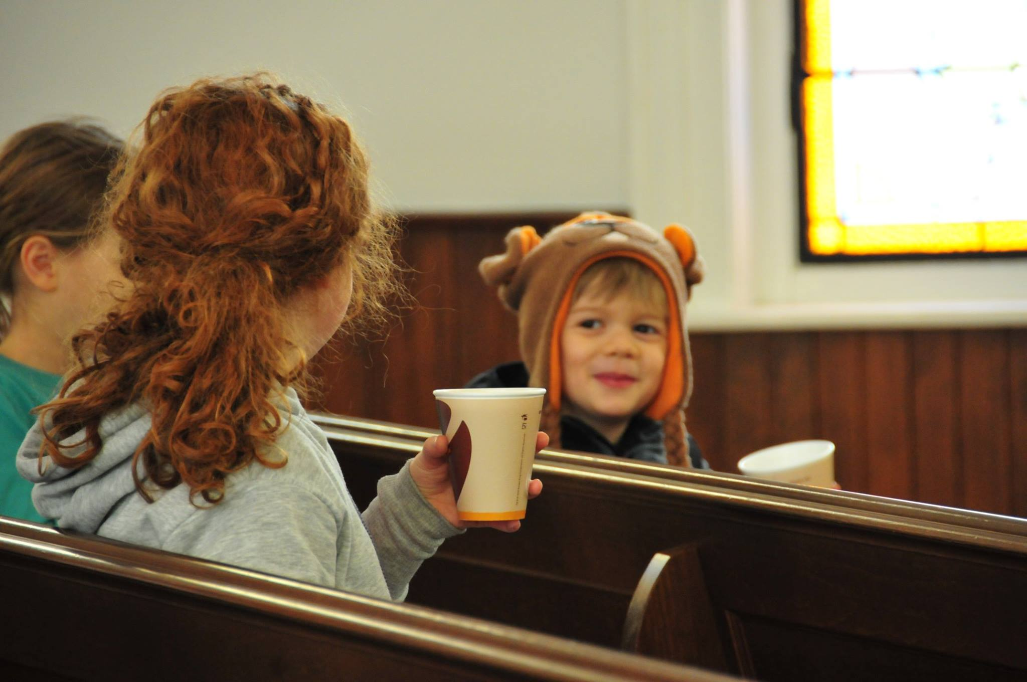 Warming up with hot cocoa inside Old Troy Church